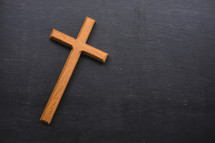 wooden cross on a slate background