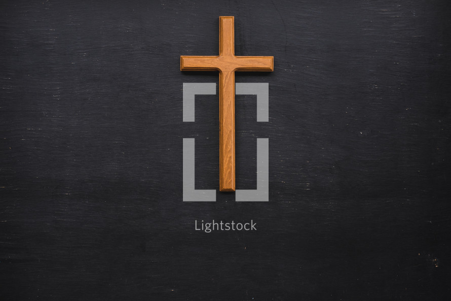 wooden cross on a black background