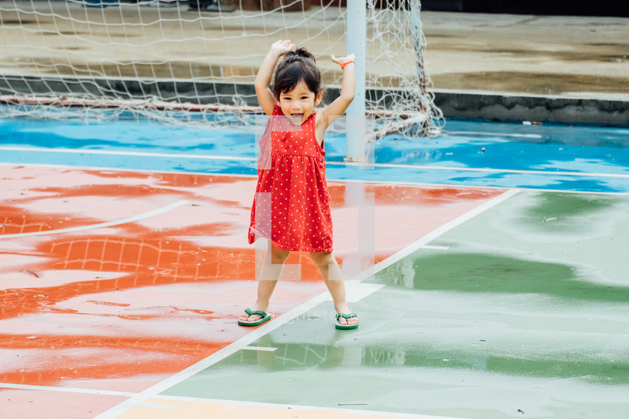 toddler on a wet soccer field