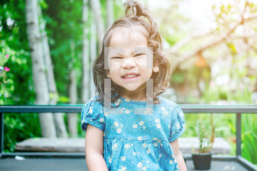 child with a silly face