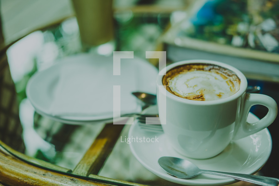 latte on a glass table