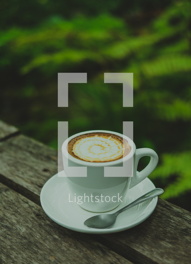 a coffee cup on a wood table