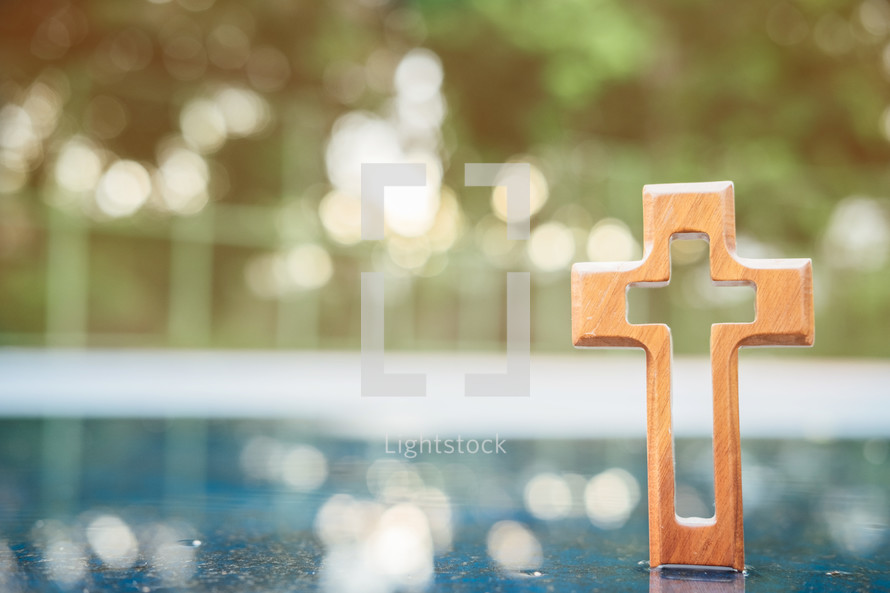 wooden cross in water