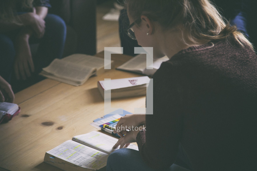 people and Bibles on a coffee at a Bible study