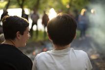 boys talking outdoors