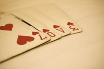Love written using numbers on playing cards