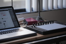 laptop and sound production equipment