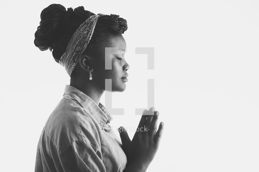 woman in prayer with white background.