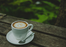 a latte on a wood table