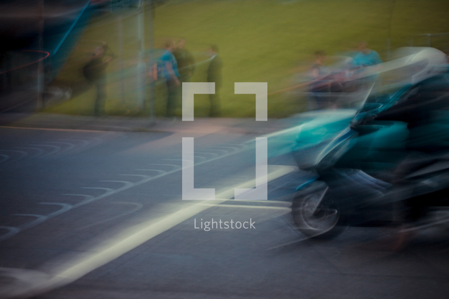 Speeding motorcycle.