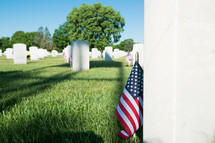 American flags near graves on Memorial day