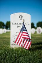 American flag near a grave