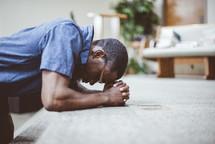 a man kneeling in prayer at an altar