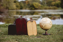 suitcases and a globe