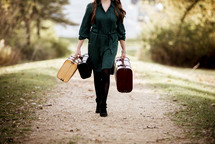 a woman walking carrying luggage