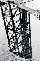 bridge reflection in a puddle of water