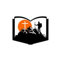 a man hiking a mountain and cross on a Bible