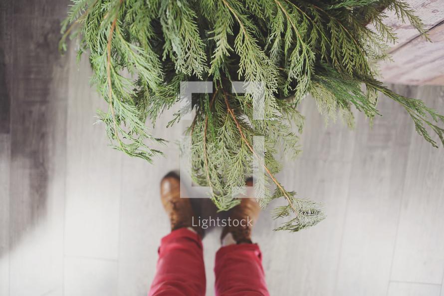 feet and Christmas greenery