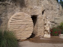 The empty tomb of Jesus with the roman seal broken and the stone rolled away showing an empty tomb and a resurrected Christ who cannot be held by the grave, death or hell. Very realistic photo of the tomb of Jesus with a roman soldier statue as a reminder that all the armies in the world cannot stop the resurrection of Jesus. During the time of Jesus death, Rome was worried that the Jews would try to steal the body of Jesus to validate rumours of Christ being resurrected from the tomb.