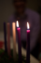 flames on a candle on an Advent wreath