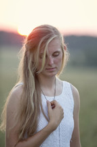 woman touching her necklace