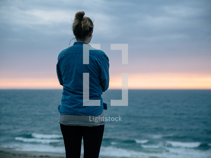 woman looking out at the ocean