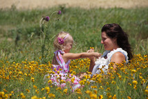 Mother and daughter in field of flowers - Mother's Day