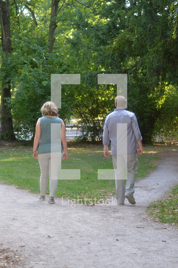 couple separating at a junction into different ways