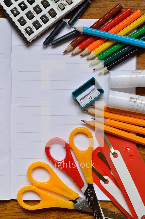 Colorful school supplies  on a desk