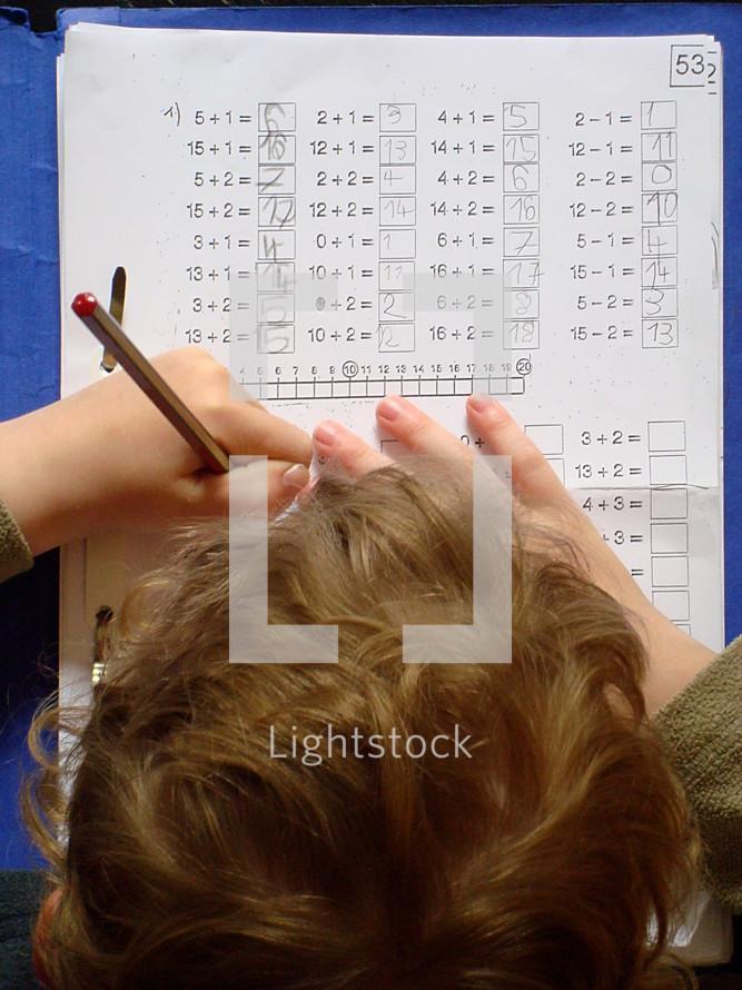 pupil doing homework pupil, school, schoolchild, child, homework, student, schoolkid, school kid, school child, school supplies, prep, home work, preparations, learn, learning, teach, teaching, kid, maths, math, mathematics