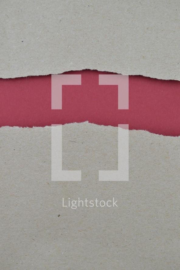 gray torn paper exposing red