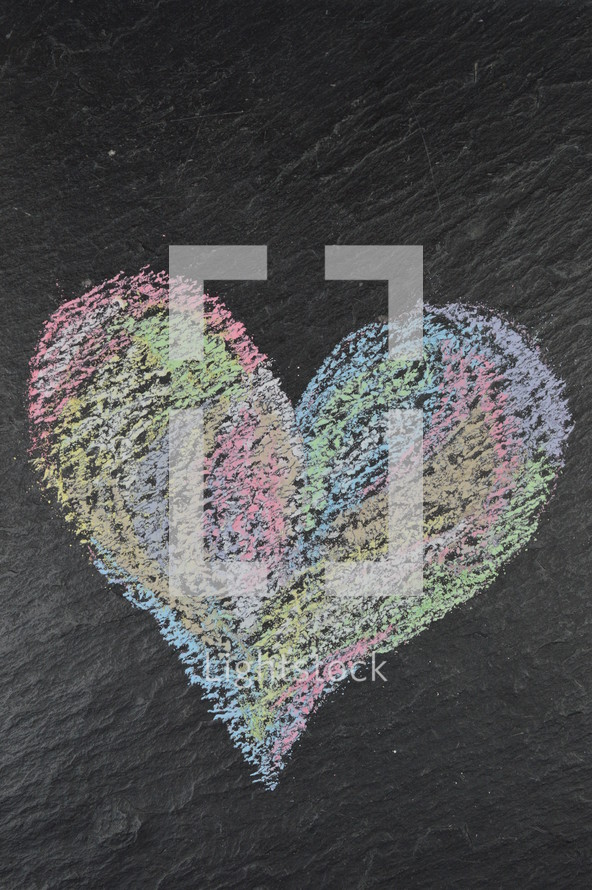 heart shape in sidewalk chalk on slate with copy space above