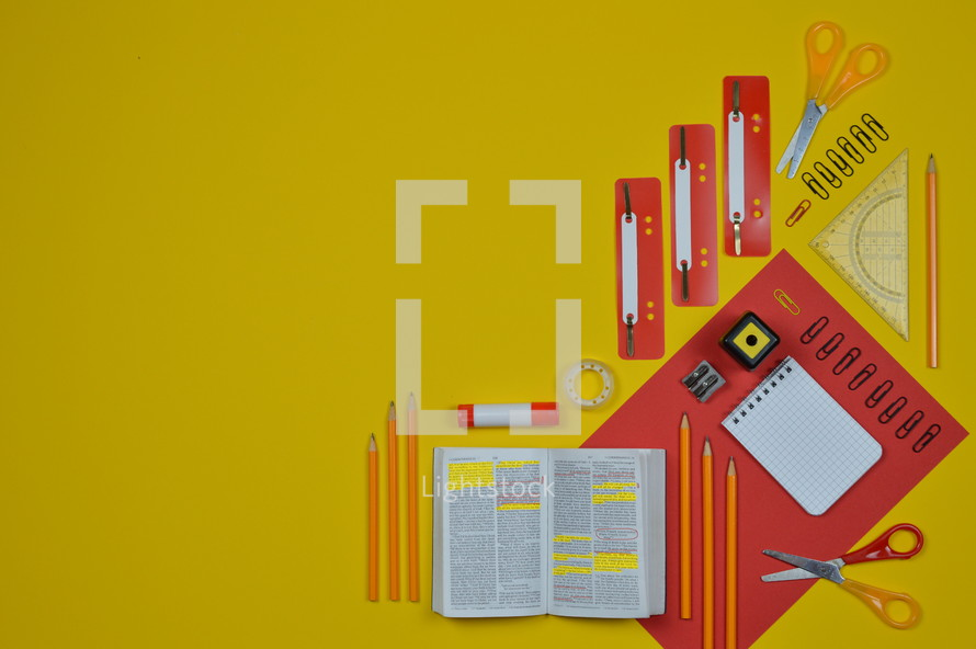 office supplies in red and yellow and Bible