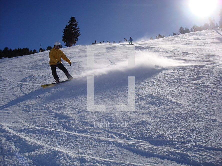 snowboarding down the slopes