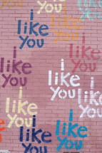 words I LIKE YOU painted on a brick wall