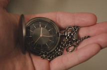 pocket watch in a man's hand