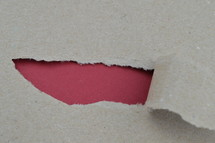 ripped paper revealing red blank space for words