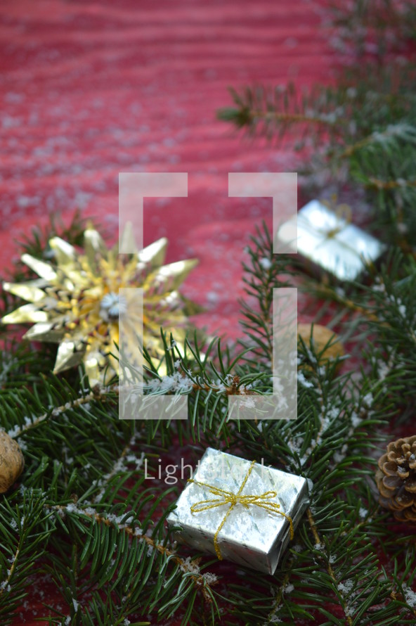 pine needles, pine cones, and ornaments