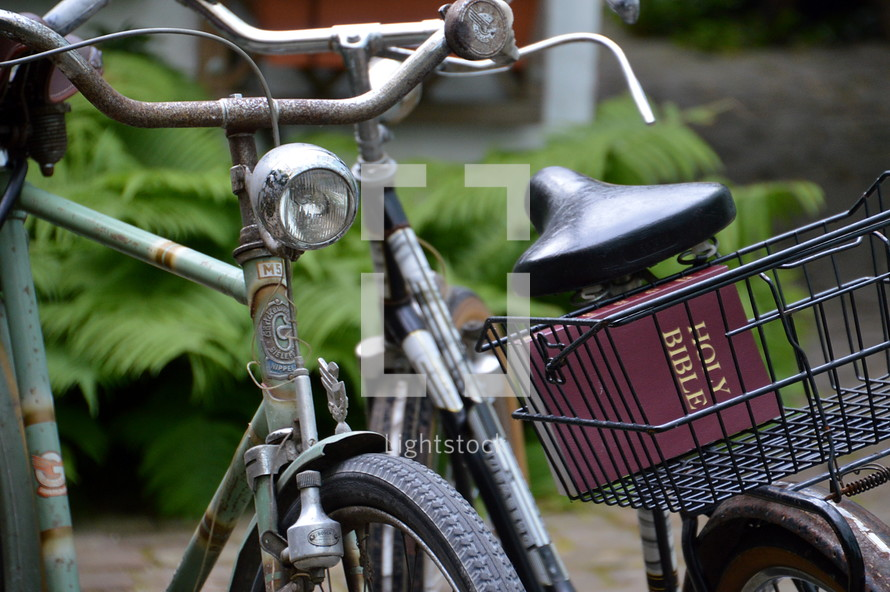 old bikes with a bible in the bicycle basket,  basket, Bible, bike, pack, with, bicycle, bikes, bicycles, cycle, cycles, ride, riding, mobile, sport, sports, outdoor, lot, many, plenty, much, mobility, acitve, actively, action, move, engage, travel, along, park, parked, parking, layby, take along, on the move, underway, on the way, on the road, old, antique, ancient