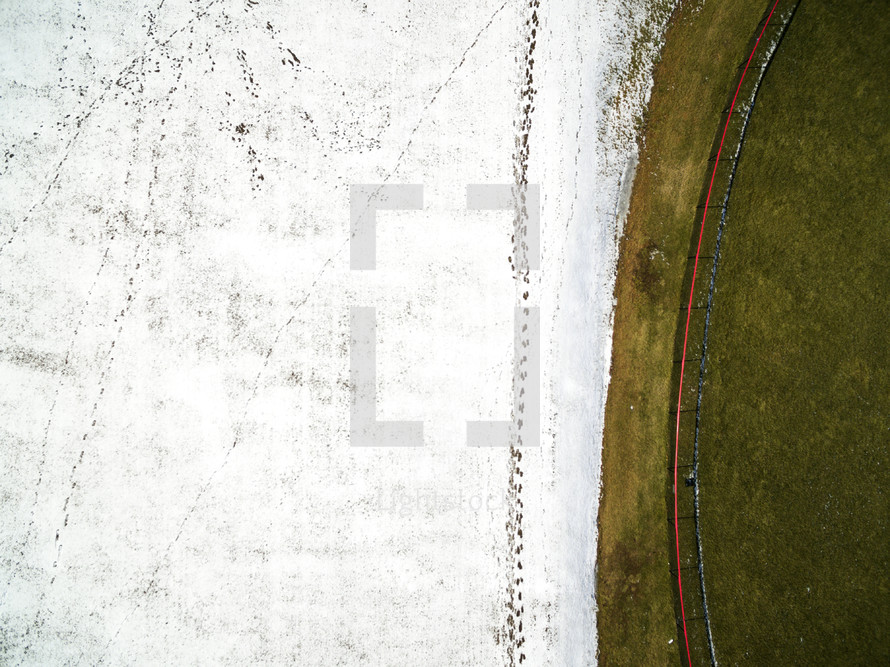 aerial view over rural farmland covered in snow
