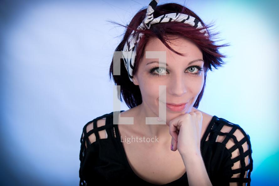 Woman with burgundy hair posing