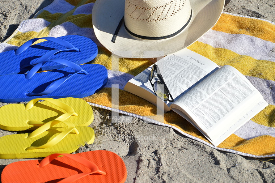 reading the bible at the beach in the family vacation.  Bible, read, reading, study, studying, quiet time, quiet, time, family, summer, vacation, beach, sand, ocean, swimming pool, swim, swimming, free, free time, summertime, holiday, holidays, families, fun, sun, happy, colorfully, colorful, color, multicolored, blue, red, yellow, orange, flip flop, sandal, sandals, bathing shoe, bathing shoes, shoe, shoes, bathing, bath, thong, thongs, beach slide, beach slides, play, playing, relax, relaxing, chill, chilling, towel, glasses, sunglasses, sunhat, sun hat, sun bonnet, bonnet, sun shade, shade, sunshine, sun, shine, shining, size, different, various, father, mother, child, children, open, Corinthians