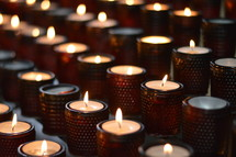 prayer candles in a church