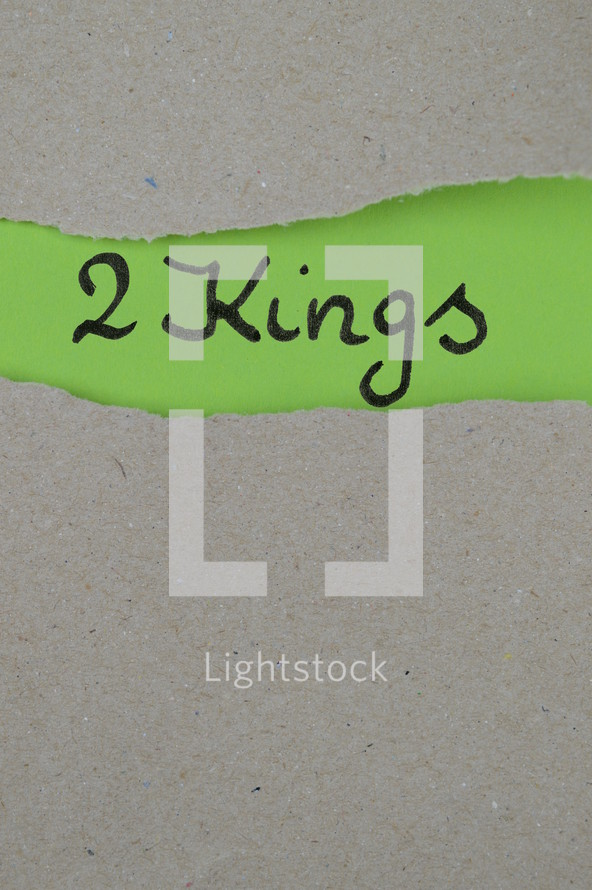 torn open kraft paper over green paper with the name of the book 2 Kings