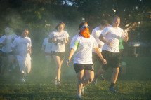 teens running in a color run
