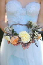 bride holding a crown of flowers