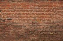 Crumbling old Red brick wall