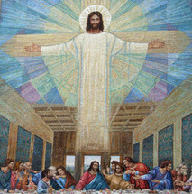 A large mural painting of Jesus over a painting depicting The last supper painting from early church art history.
