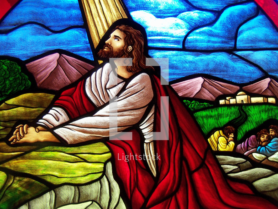 A stained glass window depicting Jesus praying in the Garden of Gethsemane while His disciples fell asleep In the background just before He was turned in by Judas to the Roman army for 30 pieces of Silver.