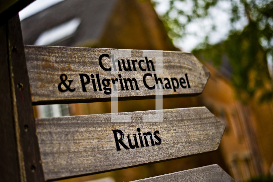 church and pilgrim chapel ruins arrows sign